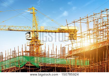 Scaffolding and cranes for modern construction sites