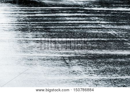 Grey Wet Asphalt Road With Raindrops On Water Puddles During Autumnal Rain