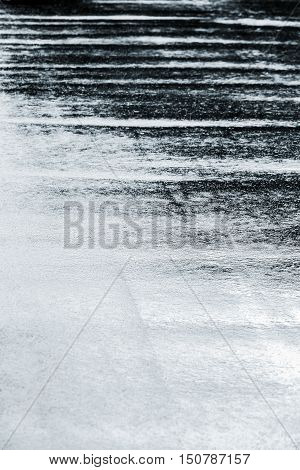 Water Puddles With Raindrops Rippling In Autumn Season