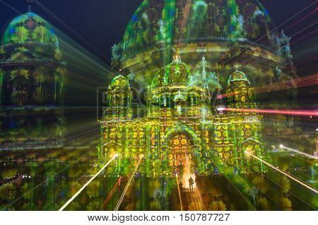 BERLIN GERMANY - OCTOBER 19 2014: radial defocused double exposure of Berliner Dome illuminated at world famous Festival of Lights. The 2016 event will take place from 7th to 16th october