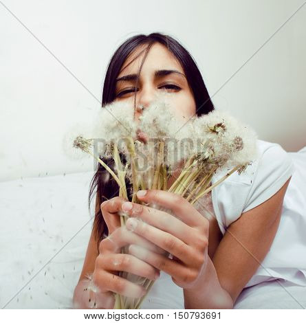 cute mulatto indian girl with dandelion smiling, lifestyle people concept close up