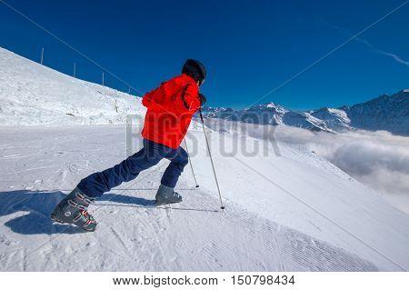 Young skier warming-up before skiing in Elm ski resort Switzerland