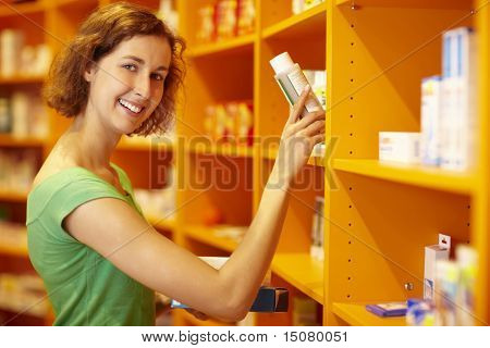 Taking Medicine From Shelf