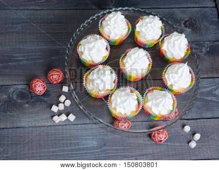 rainbow merengue cupcakes on with rattan decoration