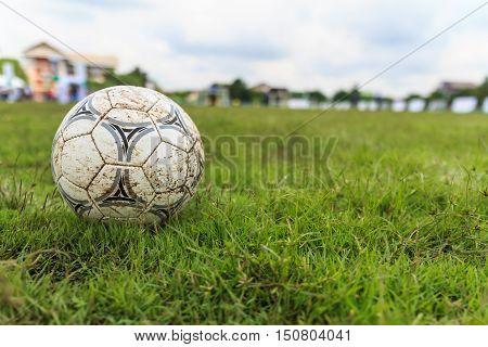 Nakhon Ratchasima Thailand - October 1 : Muddy soccer ball on a football field in Municipal Stadium Nakhon Ratchasima on October
