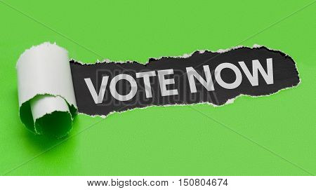Torn Green Paper Revealing The Words Vote Now