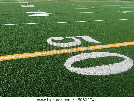 bright green football field fifty yard line