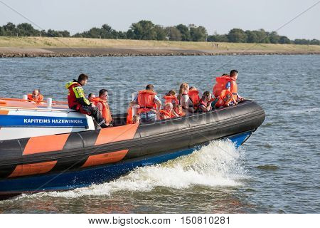 URK THE NETHERLANDS - SEP 24: Unknown people making a boat trip at a lifeboat demonstration on September 24 2016 in the harbor of Urk the Netherlands