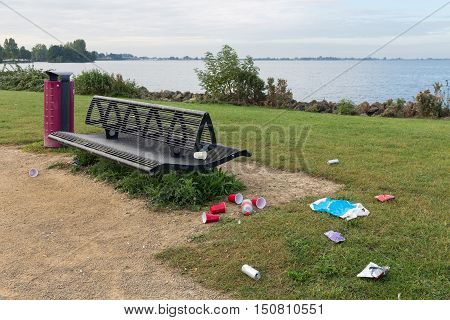 Uncollected rubbish at picnic place near Dutch lake