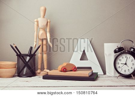 Designer artistic desk website header hero image with wooden artistic figure