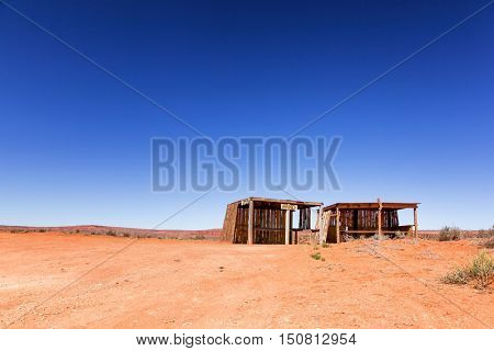 Old abandoned shack in desert. Arizona, Utah border, United States. Space for text.