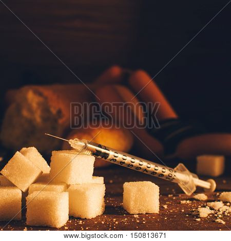 Disease - diabetes. Sugar, syringe for injection, harmful food