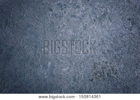 Old metal surface background covered with the whitewash