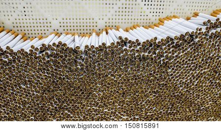 Cigarettes production and packing line in tobacco factory