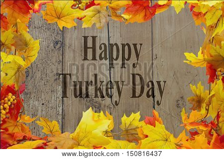 Happy Turkey Day Message Autumn Leaves with grunge wood with text Happy Turkey Day