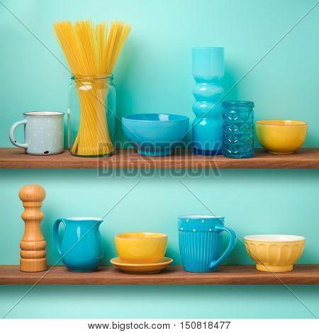 Kitchen wooden shelf storage with decorative tableware
