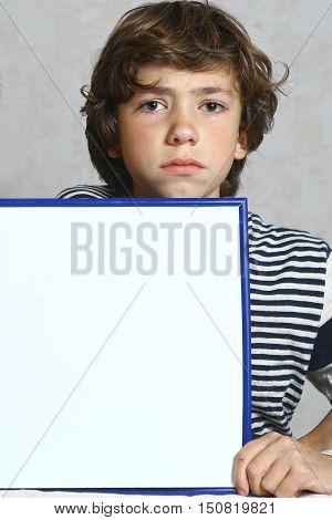 boy hold blank paper rectangular frame close up photo