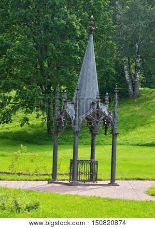 Old metal gazebo over time bent to the side