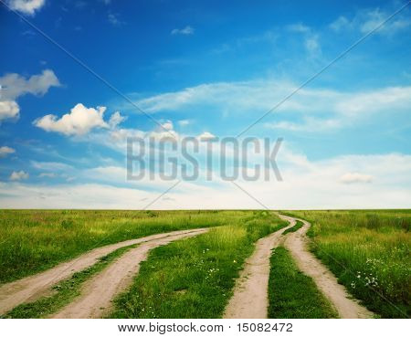 two country roads in the green fields