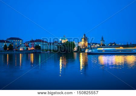 Viewing on Vltava river and Prague cityscape at night
