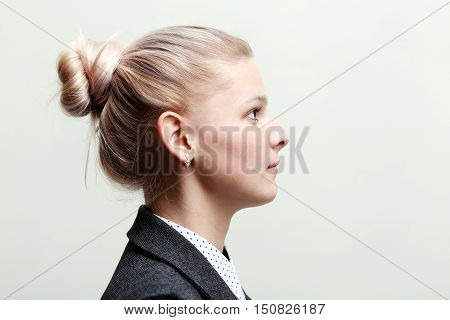 Girl profile face. Woman profile on a gray background.