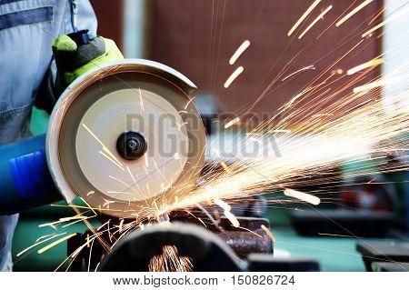 A metal sawing close up. A Grinder