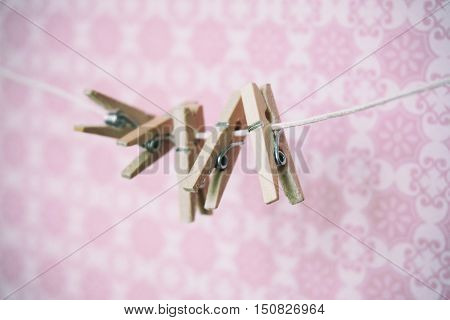 Many Small Pegs On A Pink Background