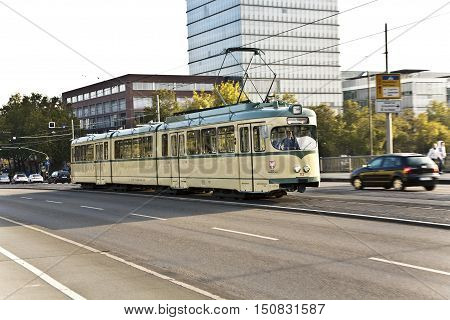 FRANKFURT GERMANY - OCT 21 2009: historic streetcar trolley at the Friedensbrücke in Frankfurt in Germany Frankfurt on a museum ride.