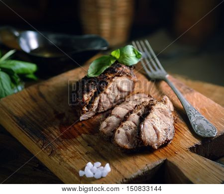 grilled meat, basil on a wooden background