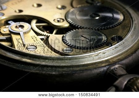 Pocket watch inside with wheels and springs close up