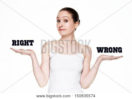 Beautiful woman holding words right and wrong on white background
