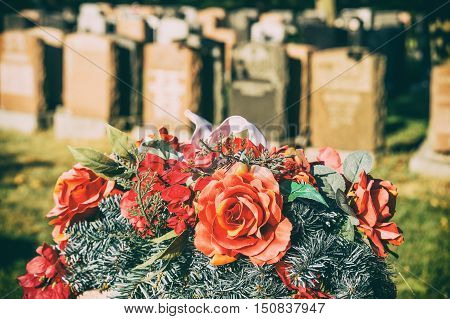 Roses In A Cemetery With Headstones In The Background (faded Retro Effect)