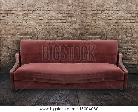 dirty sofa in old room