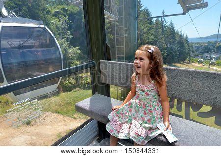 Girl travel on Gondola Cableway on Mount Ngongotaha in Rotorua New Zealand.