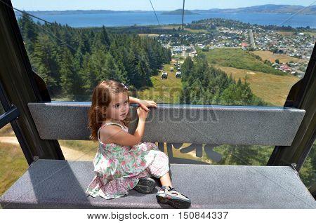 Young Girl Travel On Skyline Gondola