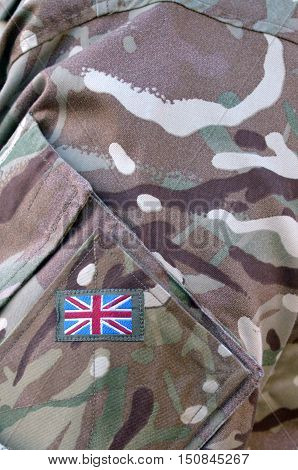 British Army soldier camouflage uniform with the national British Flag Badge on It. background texture