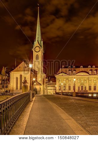 Clock tower of the Fraumunster Cathedral in the city of Zurich, Switzerland, at night. A HDR image with tone mapping applied.