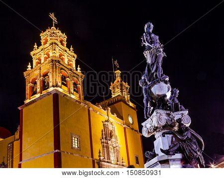 Our Lady of Guanajuato Paz Peace Statu Night Stars Guanajuato Mexico. Statue donated To City by Charles V Holy Roman Emperor in the 1500s. Steeple Towers Basilica de Nusetra Senora Guanajuato Mexico
