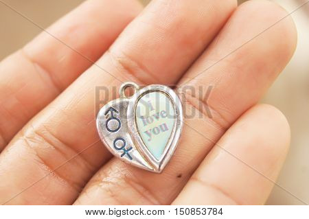In the hands Hold heart Pendant Style have English vocabulary I LOVE YOU.