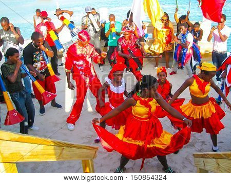 Boca Chica, Dominican Repablic - February 12, 2013: Resident people celebrate Caribbean Carnival on the Beach