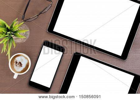 phone and tablet blank screen on table top view mock up smart phone and digital tablet