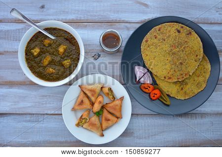 Flat Lay Of Paratha Flatbread Indian Cuisine Served With Traditional Punjabi Palak Paneer Dish