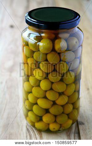 Studio photo of marinated green Spanish preserved olives