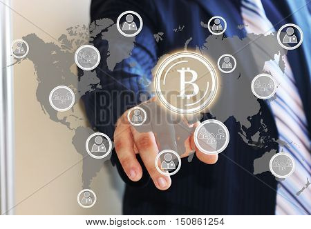 Businessman,choosing bitcoins presses the touch screen with world map.The latest technologies operate the Finance in a network.The concept of distribution of bitcoins. Global business concept bitcoin.