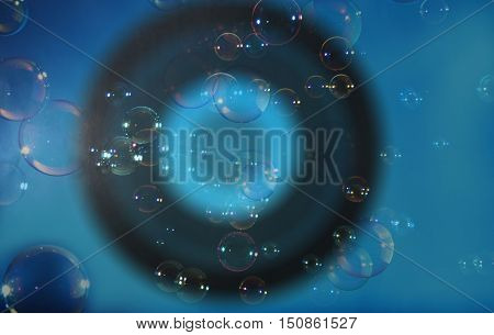 Rainbow soap bubbles on a blue dark backgrounds