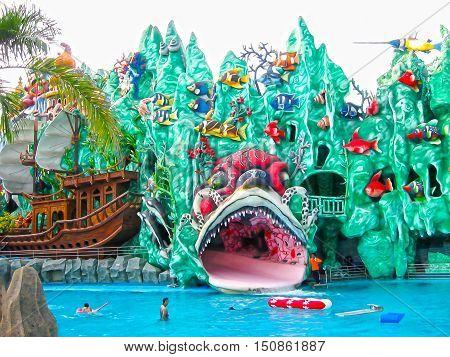 Ho Chi Minh City, Vietnam - February 10, 2011: people enjoy the vacation at a aquapark Dam Sen Park