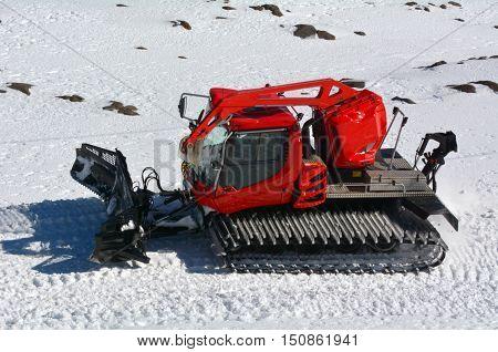 Red Snowcat Travels On Snow