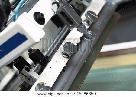 Detail of silk-screen printing machines. Macro photo