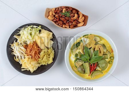 Green fermented flour curry  with mixed vegetables and spicy fried textured soy protein curry served with side disk as bean sprouts,cabbage,sweet radish and pickle
