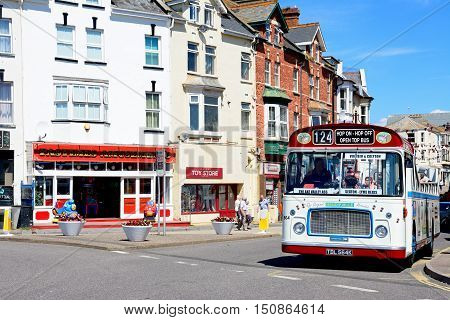 SEATON, UNITED KINGDOM - JULY 18, 2016 -Bristol RE tour bus along a town centre shopping street Seaton Devon England UK Western Europe, July 18, 2016.